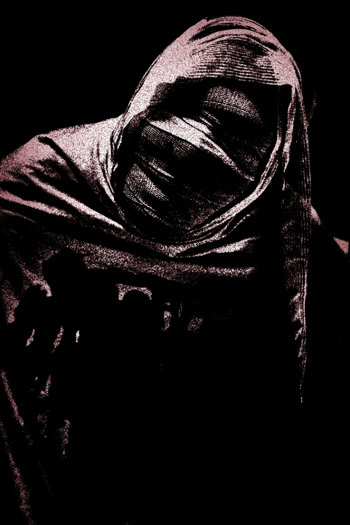 face of a mummy in the dark