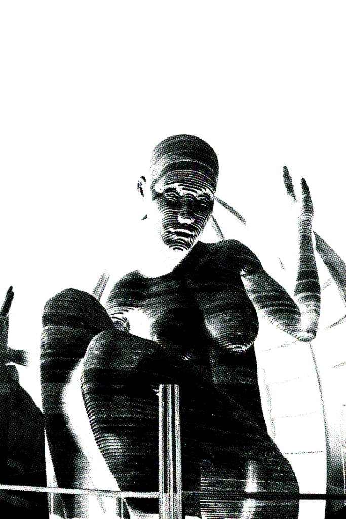 black and white photography of a human statue